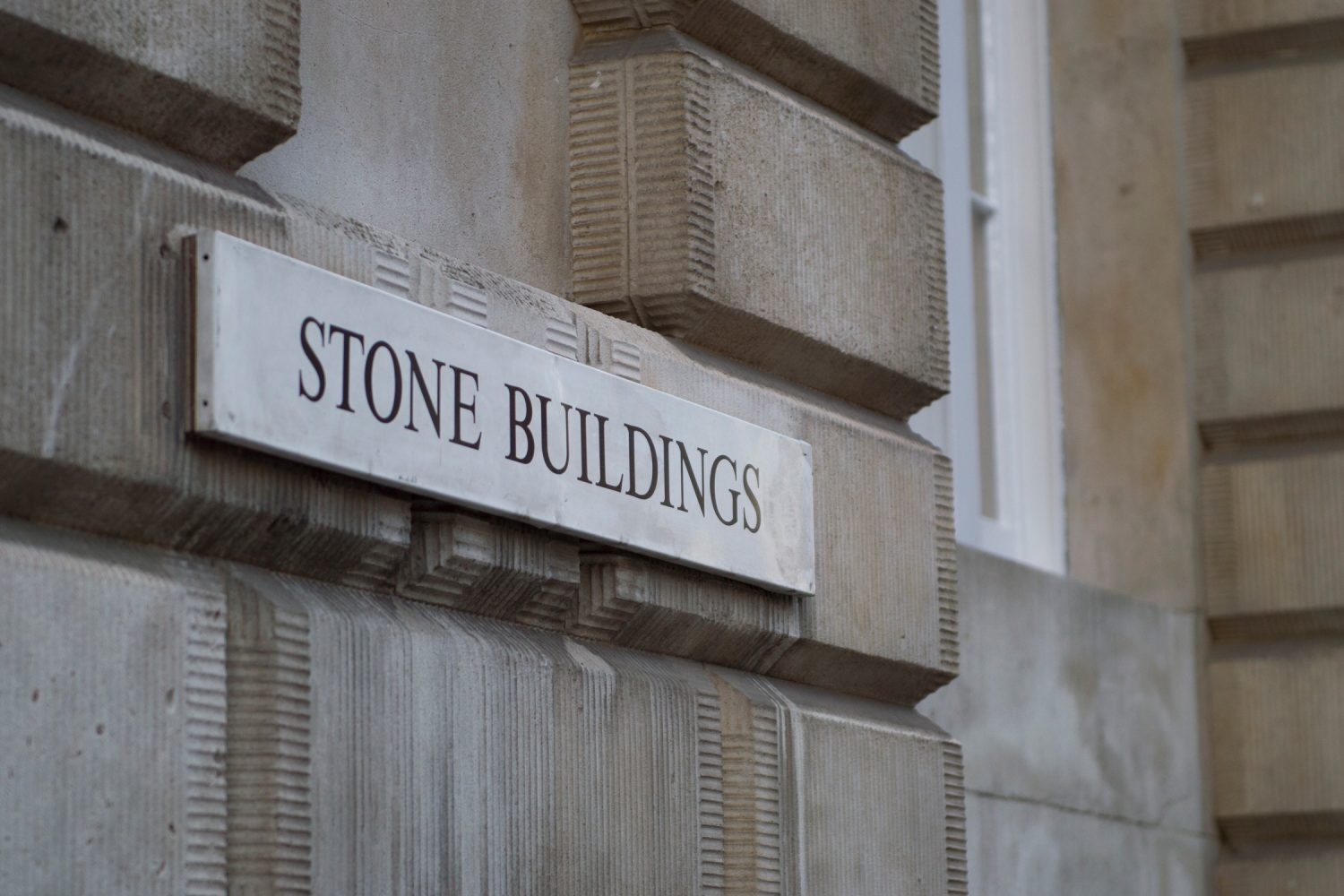 5 Stone Buildings - building sign