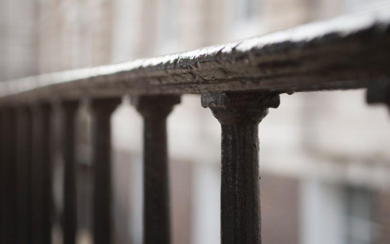 5 Stone Buildings iron railings outside